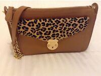 Tan and leopard handbag
