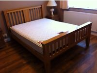 King size solid oak bed frame with a firm spring mattress included. All in vey good condition.