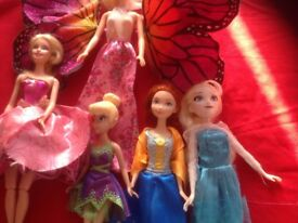 Barbies and Frozen dolls and Tinkerbell doll