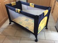 Folding travel baby cot with mesh sides, folds into carry bag, narrow and long shape