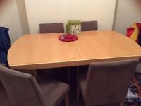 Extending dining table with 6 chairs £150