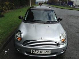 Mini Cooper for sale. This silver car is in excellent condition both inside and out.
