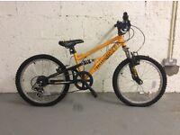 Bicycles - Hardly used Boys Stomp bike and Ladies Indi Maverick with helmet