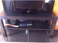 Flat screen TV and black TV bench