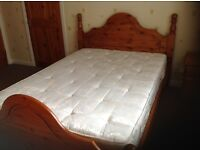 double bed with pine headboard, excellent condition nearly new