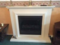 Electric fire set in cream fire surround & hearth