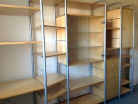 Shelving unit includes desk, display cabinet,cupboard and drawers. Suitable for student bedroom.