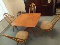 Ercol extendable dining table and 4 chairs