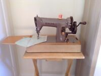 Singer 185K hand crank sewing machine, with case and attachments, 1959.