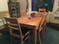 Solid Oak Dining Room Table and six matching chairs