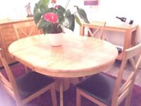 Round wooden table and 6 chairs. Extendable to oval.
