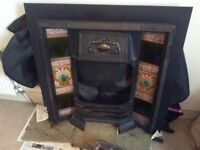 Beautiful cast iron fire surround with inlaid tiles