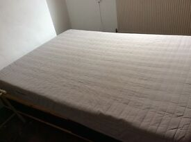 Double bed, futon style, but is not a couch.