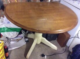 """Round drop leaf table approx 43""""round when extended.wooden top cream legs solid."""
