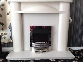 Fire surround (marble) and remote control electric fire. Good quality and condition.