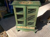 Miniature painted glazed bookcase with drawer