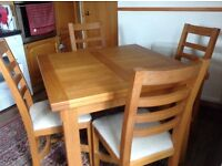 Solid oak dining table ext to 6ft. Matching 4 chairs