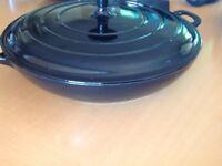 Black shallow new cast iron casserole dish and lid