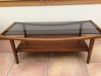 Vintage coffee table with smoked glass top. Great condition. Unused and been in storage.
