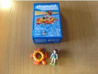 4860 Playmobil girl in rubber ring