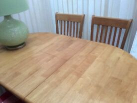 Table and chairs excellent condition.