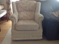 Arm chair upholstered in light cream/beige.
