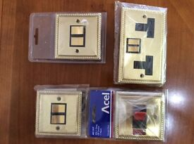 4 assorted Georgian solid brass electrical fittings
