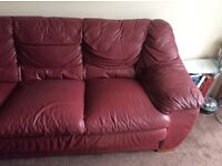 Burgundy three seater sofa leather with cream cover available