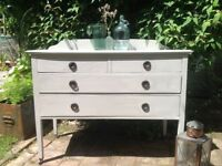 Antique chest of drawers with casters and back plate
