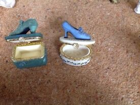 2 China trinket boxes with shoes on top