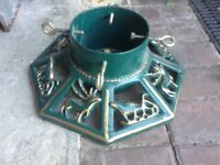 Cast iron Christmas tree stand heavy with 4 fixing bolts.