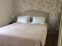 Two M&S sprung divans with mattresses plus optional headboard
