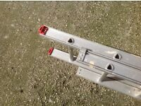 Double extension alluminium ladder. 12 treads per section