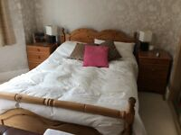 Pine wood double bed frame.