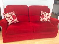 Alstons two-seater Sofa Bed red as-new