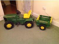 John Deere toy tractor with trailer