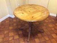 Solid pine kitchen table and chairs in excellent condition.