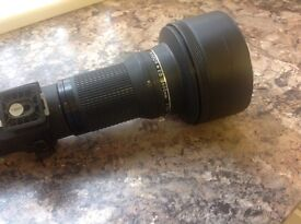 Nikon, Nikkor 600ml lens in good, but used, condition. It comes with a case, and lens cover