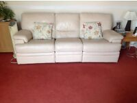 Reids Three seater leather sofa with manual recliners
