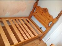 Pine four poster single bed with bow carved headboard