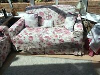 Chintz covered settees