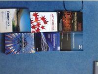 University Economics, Psychology, Finance and Politics course books.