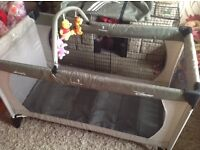 Large Green Disney Hauck Winnie the Pooh Hauck Travel cot, playpen toy bar and mattress £25