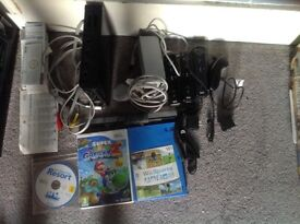 Nintendo wii with three remotes, two motion sensors, nunchuck, wii fit balance board and 5 games