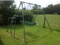 Childs TP double swing frame with pirate boat swing and single swing.