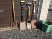 Muck graip, two builders shovels and a small garden spade
