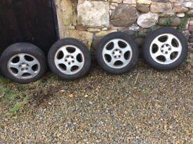 Alloy wheels from a 2000 Subaru Legacy 195/60 /R15