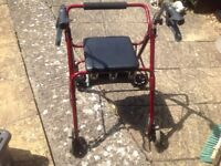 Walker with seat and brakes. Allso zimmer