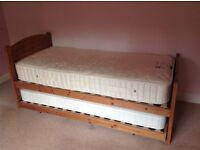 Marks and Spencer quality pine single bed with hideaway guest bed. Mattresses included.