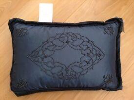 Blue beaded cushion